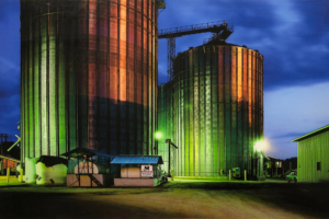 Grain bins at dusk